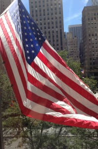American Flag waving over Rockefeller Center, NY
