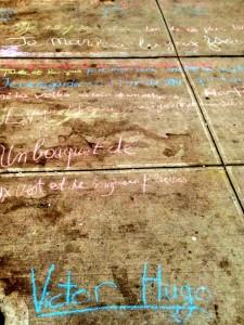Quoting Victor Hugo with sidewalk chalk